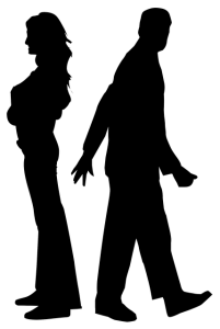 a man and a woman in silhouette walking away